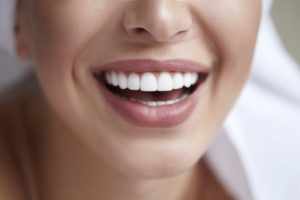 woman happy with cosmetic dentist