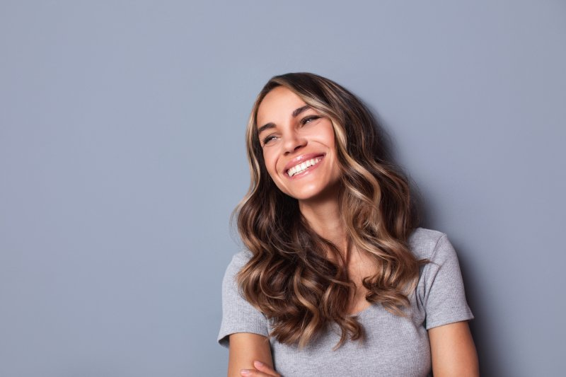 Woman smiling with straight, white, beautiful teeth