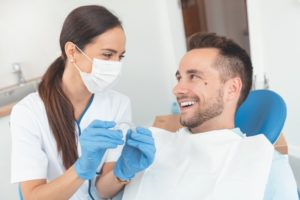 Invisalign provider in Carlsbad showing a patient how Invisalign works